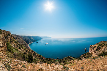 Panoramic seascape, calm azure sea and bright sun. Copy space. The concept of calmness, silence and unity with nature