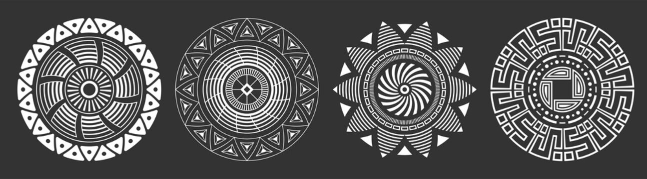 Set of four abstract circular ornaments. Decorative patterns isolated on black background. Tribal ethnic motifs. Stylized sun symbols. Stencil tattoo and prints Vector monochrome illustration.