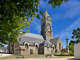 Church among tree of Noirmoutier en l'Ile in Pays de la Loire, region in western France