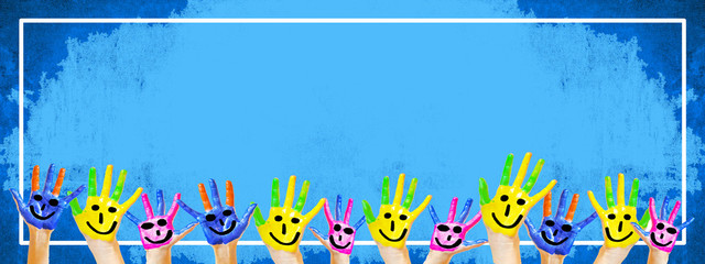 School / kindergarten background Background banner panorama - Many brightly painted children's hands in front of a old aged empty blue chalkboard with white frame and space for text