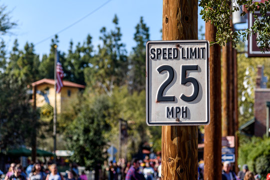 25 mph speed limit sign, attached to a wooden post