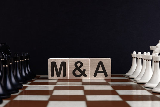 Chessboard With Wooden Blocks Showing Mergers And Acquisitions Concept