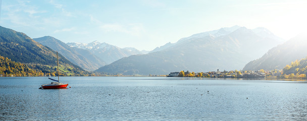 Fotomurales - Stunning Nature Landscape. Wonderful Sunny day in Autumn. Panoramic view of beautiful mountain landscape in Alps with Zeller Lake in Zell am See, Salzburger Land, Austria