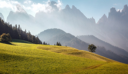 Fotomurales - Fairy velley in Dolomites mountains under sunlit. Amazing nature Background. Epic Scenery