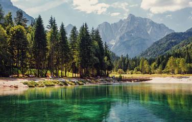 Fotomurales - Jasna lake in Julian Alps, Kranjska gora. Wonderful summer landscape of Triglav National Park. Sunny scene of Julian Alps, Gozd Martuljek location, Slovenia, Europe. Awesome Nature Scenery