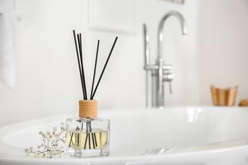 Reed diffuser in modern bathroom