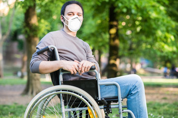 Portrait of a masked man on a wheelchair during coronavirus pandemic