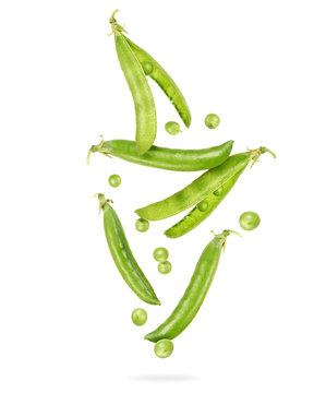 Uncovered pea pods in the air, isolated on a white background