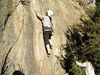 Woman Girl Rock Climber on Rock Face