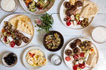 Greek meze meal with lamb meatballs, hummus and salad