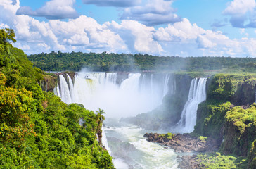 Iguazu waterfalls in Argentina, view from Devil's Mouth. Panoramic view of many majestic powerful water cascades with mist and splashes. Panoramic image of Iguazu riverside, river valley from above. Wall mural