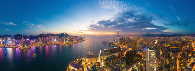 Aerial view of the Victoria Harbour, Hong Kong, at Twilight time. famous travel destination. Wall mural