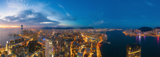 Wall Mural - Aerial view of the Victoria Harbour, Hong Kong, at Twilight time. famous travel destination.