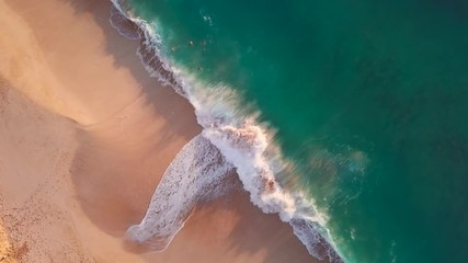 Wall Mural - Tropical beach on Oahu island in Hawaii. Top down view of the perfect sandy beach with breaking waves
