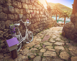 Poster de jardin Velo View of Perast street with decor bike