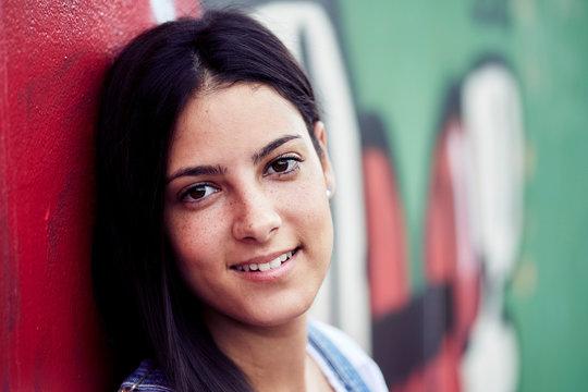 Young brunette Spanish girl smiling