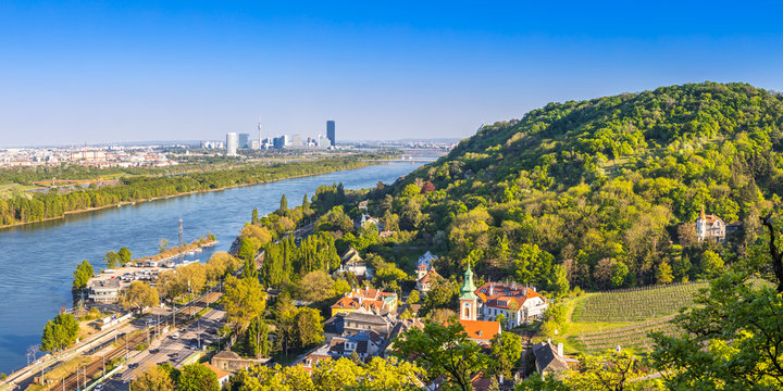 View of Vienna suburbs - Kahlenbergdorf with view of danube river, danube island and Vienna skyline in the back, Austria
