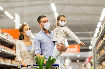 sale, family and pandemic concept - happy mother, father and little daughter wearing face...