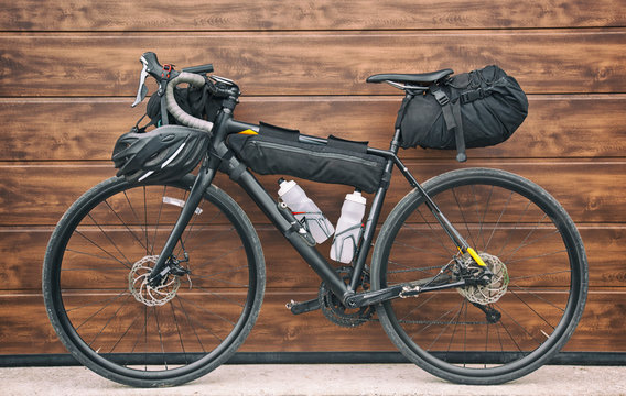 The bicycle packed with a lot of bags and other equipment ready for adventure and travel