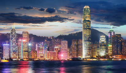 Fotomurales - Hong Kong, China skyline panorama from across Victoria Harbor