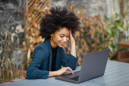 smiling african american businesswoman using laptop computer