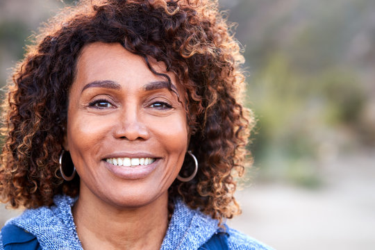 Portrait Of Smiling African American Senior Woman Outdoors In Countryside