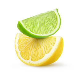 Isolated citrus fruit slices. Pieces of lime and lemon on top of each other isolated on white background