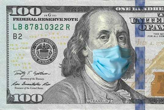 COVID-19, sars-cov-2 coronavirus pandemic going to a financial crush, one hundred dollars USA bill with Benjamin Franklin wearing a protective mask