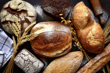 Deurstickers Brood Homemade fresh baked bread with flour and ears.