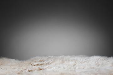 beige sheepskin texture on gray background