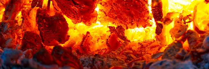 Keuken foto achterwand Brandhout textuur red hot coals in a blast furnace for metal melting. metal mining and processing industry. Red coals from a burnt fire made of wood. panoramic