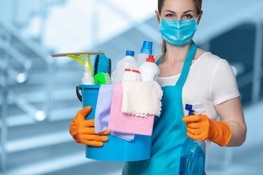Cleaning lady with tool in cleaning in mask .