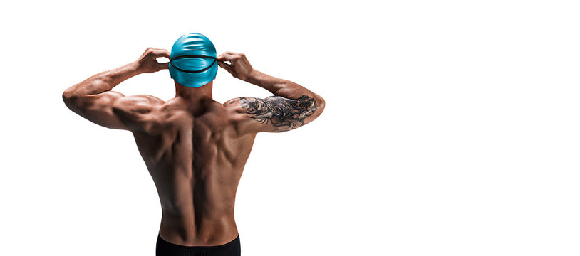 Portrait of a swimmer. The concept of swimming and water games. Back view.
