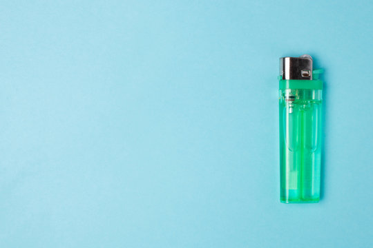 green lighter on a blue background