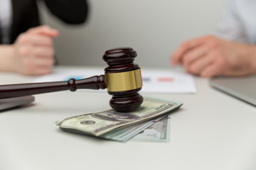 Legal alimony concept. Closeup view of wooden gavel and money