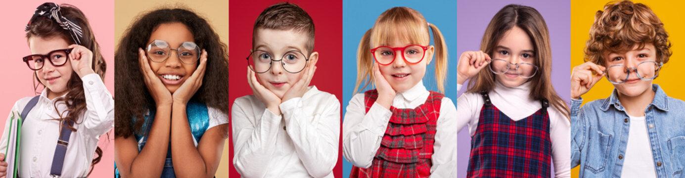 Smart diverse children looking at camera