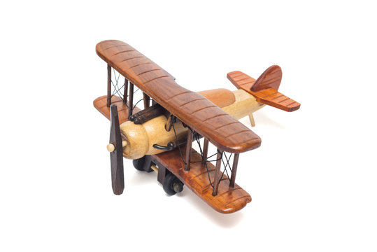 Wooden airplane model isolated on white background. Airplane isolated on a white background