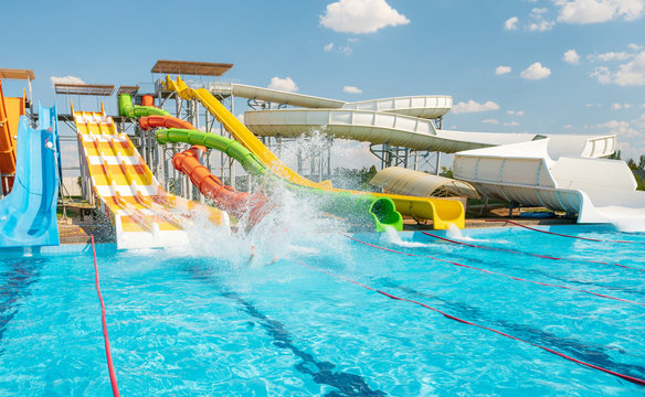 Water park with colorful slides and pools