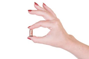 Female hand holding pistol cartridge