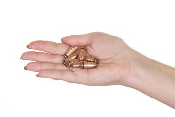 Female hand holding ammo