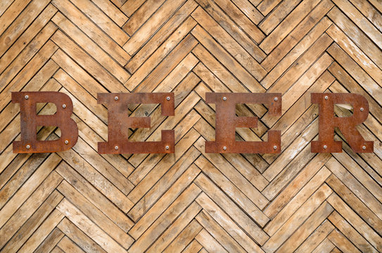 "The inscription ""Beer"" on a wooden background. Old vintage ""Beer"" sign"