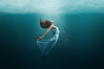 Dancer underwater in a state of peaceful levitation