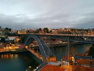 Fotorolgordijn Sydney Illuminated Bridge Over River Against Cloudy Sky