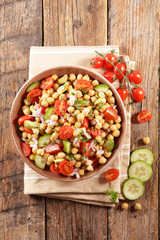Fototapete - chickpea salad with tomato and avocado