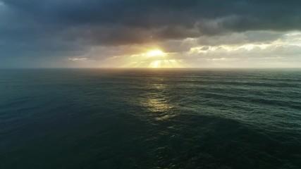 Fototapete - Aerial view on big waves of Atlantic ocean and dramatic sunset sky, 4k