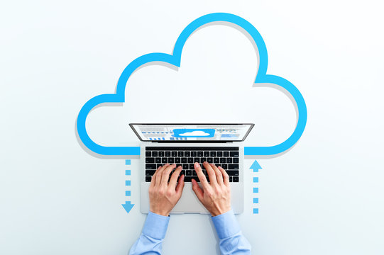Cloud computing technology. Business man using laptop. Upload and download files.