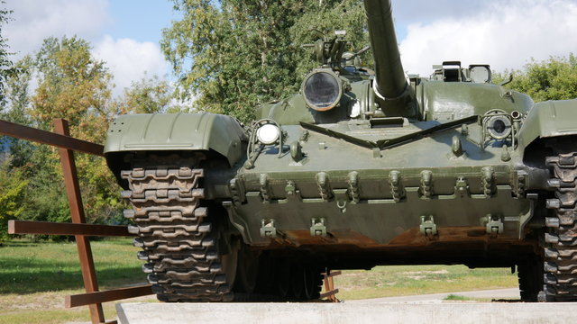 monument green tank t-72 in the summer during the daytime