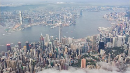 Fototapete - Aerial time lapse of Victoria Harbour, Hong Kong, at evening, cloudy day