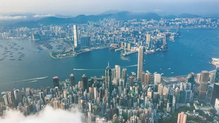 Fotomurales - Aerial time lapse of Victoria Harbour, Hong Kong, at evening, cloudy day