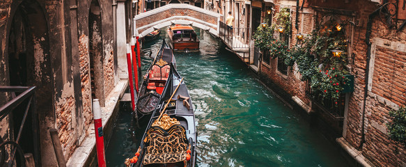 Canal with gondolas in Venice, Italy.